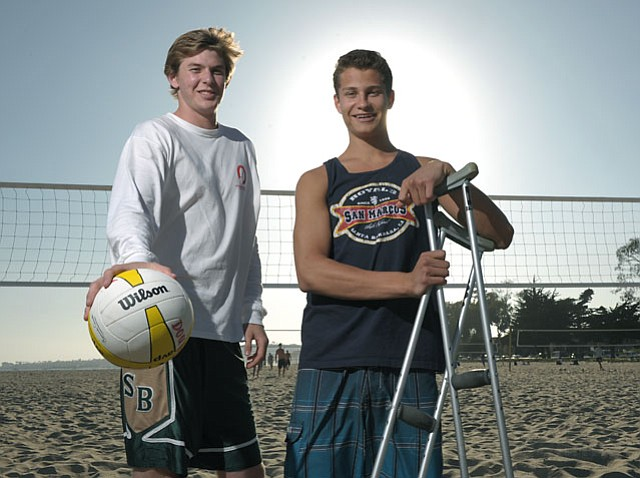 Though San Marcos Royal Johnny Manzo (right) and S.B. Don Clifford Anderson both fell victim to injuries their last year of high school volleyball, they are looking forward to a fresh start next fall at Harvard and UCLA, respectively.