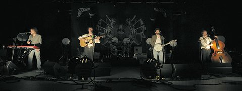 "The band (from left): Ben Lovett, Mumford, ""Country"" Winston Marshall, and Ted Dwane."