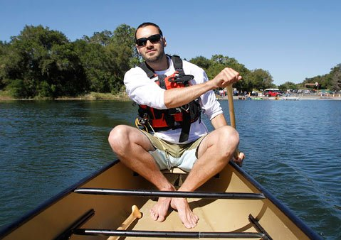 Fraser Kersey of Channel Island Outfitters took a spin in a canoe after a ceremony to mark paddle boat access on Cachuma Lake.