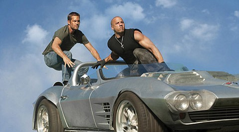 <strong>CRUISE CONTROL:</strong>  Paul Walker (left) and Vin Diesel reunite for the stunt-heavy, dialogue-light <em>Fast Five</em>, the latest installment in the <em>Fast and Furious</em> franchise.