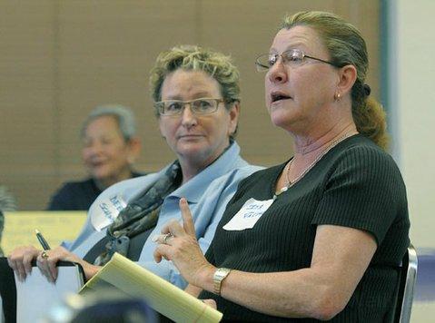 Deborah Schwartz (left) and Iya Falcone at a Democratic Planning forum March 5, 2011