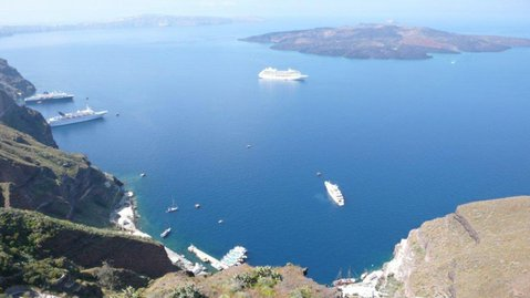 Cruise ship Azamara Journey, center distant, in Santorini Bay.