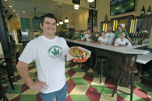 Manager Doug Tobe (left) and the Three Pickles crew have moved shop one door up to the historic and roomy Jimmy's Oriental Gardens building on Canon Perdido Street.