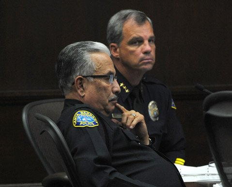 <strong>MOVING TARGET:</strong>  Police Chief Cam Sanchez (left) and Assistant Chief Frank Mannix listen as the council debates how many new cops Santa Barbara needs and how many it can afford.