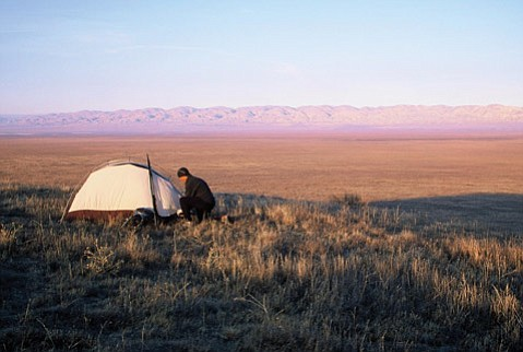The author pitches his tent on the shore of Soda Lake.