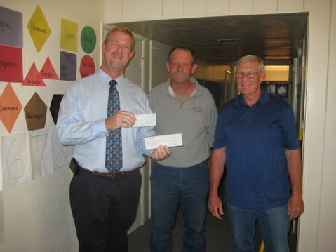 From Left to right: Brian Roney, Interim Parks Director, Mike Thorp, representing Duncan Family Farms and Biff Charlton, President of the Cuyama Valley Exchange Club.