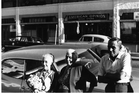 (background)  The John Birch Society's American Opinion Book Store.  (foreground) Leontine Birabent Phelan, Pearl Chase, and an unidentified gentleman (not members of the JBS).