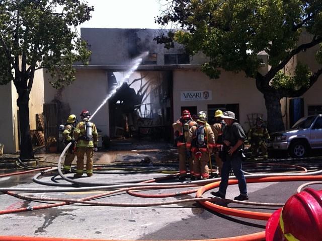 Firefighters battle blaze at 122 Santa Barbara Street, home to Vasari Plaster and Stucco.
