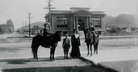 1911 era Photo of members of the pioneer Rudolph Family in front of the newly opened Lompoc Carnegie Library. Pictured Left to Right: Lucille, Kenneth, Gertrude, and Harvey Rudolph.