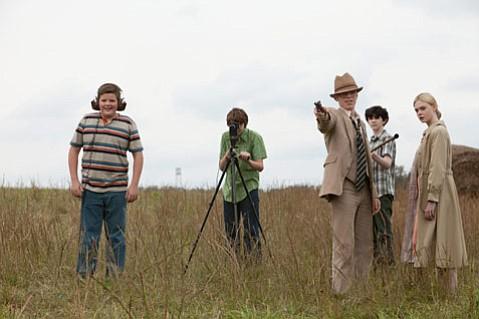 <strong>BLOCKBUSTER BLISS:</strong>  Elle Fanning and Joel Courtney lead a terrific ensemble of young actors in J.J Abrams's endearing <em>Stand by Me</em>-meets-<em>E.T.</em> mash-up, <em>Super 8</em>.