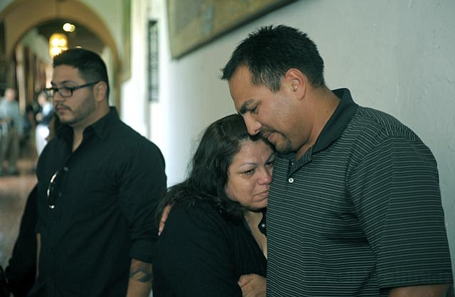 Family members of the victim, including brother German Sotelo and mother Alicia Vasquez, discuss the case outside the courtroom