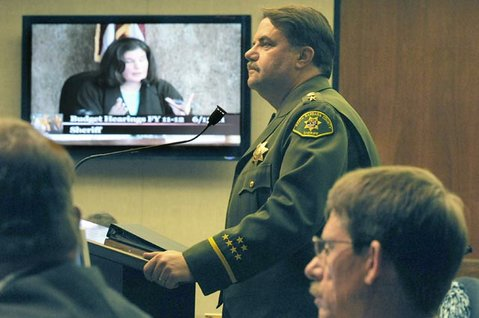 <strong>PLEADING HIS CASE:</strong>  Sheriff Bill Brown listens to questions from 2nd District Supervisor Janet Wolf at Monday's hearing. Brown's department is facing $8 million in cuts.