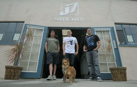 J7 Surf shop new location at Mason Street in the heart of Santa barbara's Funk Zone. Pictured (left to right) shop worker Vince Miraglia, Benny Bermudez Graphics/Web Designer, owner Jason Feist and Paco the dog