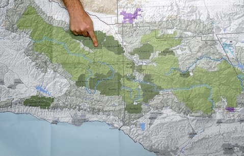 Los Padres ForestWatch's Jeff Kuyper points to the dark green areas that represent the 200,000 acres of new wilderness areas currently being considered, including a brand-new area of wilderness called Condor Ridge, located along West Camino Cielo.