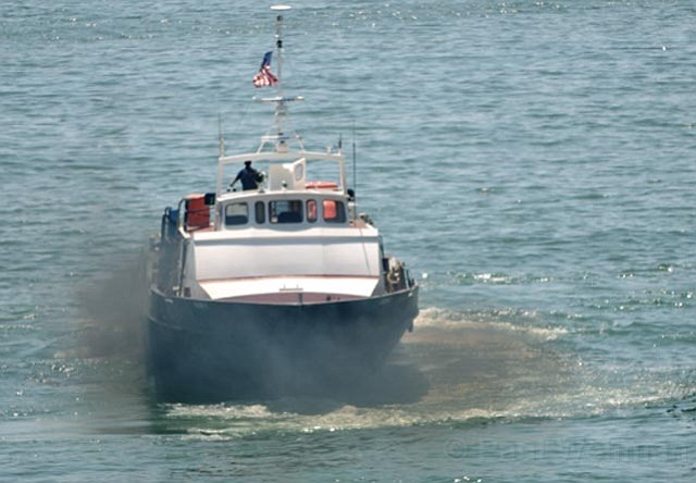 Representative Lois Capps worries that a new federal bill, if passed, would take power away from state Air Pollution Control Districts. Above, a smoggy boat leaves the dock by the seal rookery in Carpinteria.
