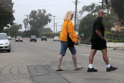 Pedestrians trying to negotiate the four lanes of traffic on Cliff Drive.