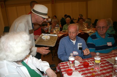 Santa Barbara City councilmember Grant House serves cake during the 90+ birthday event