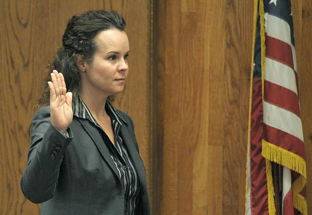 <strong>TAKING THE OATH:</strong>  Officer Kasi Beutel took the stand to testify in a pretrial hearing for what would ordinarily be a standard DUI case. The trial took a dramatic turn, however, when a recent news report tried to call Beutel's conduct — on and off the clock — into question.