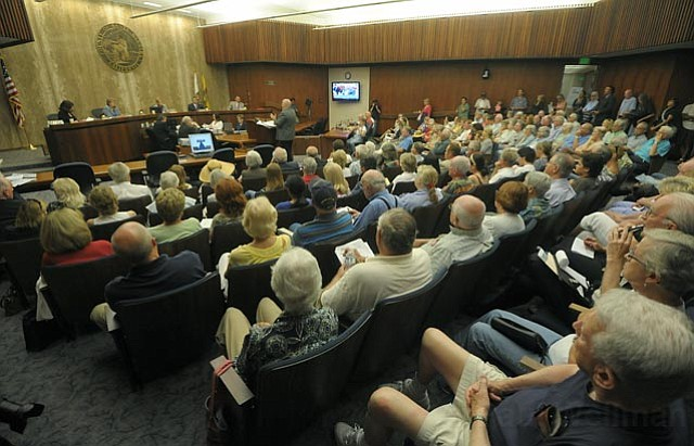 The county boardroom was packed Tuesday afternoon with residents speaking against controversial smart meters