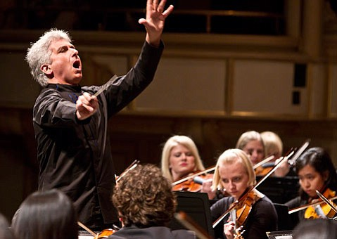 Peter Oundjian gives expression to his conducting of the Academy Festival Orchestra.