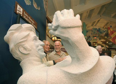 Ernie Brooks (center, left) poses for photos with his newly unveiled statue by artist Viktor (center, right) at the Santa Barbara Maritime Museum July 23, 2011