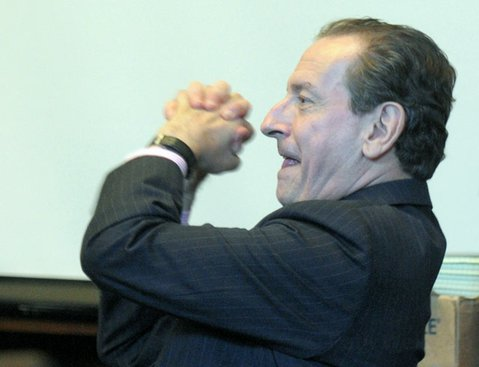Peter Lance, after being admonished last Tuesday by Judge Brian Hill for giving a thumbs-up to a witness, responds with a more dramatic gesture of approval (July 26, 2011).