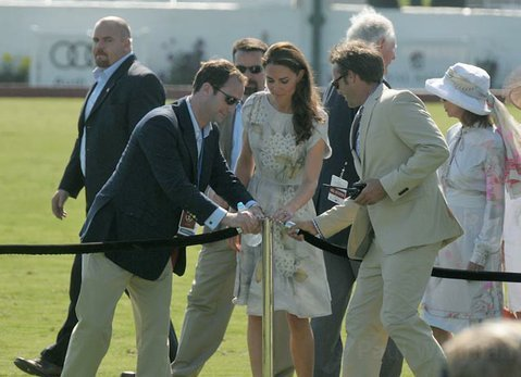Kate Middleton arriving on the field to present awards.
