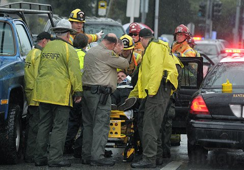 Law enforcement and medical personnel attend to Todd Kadell in the aftermath of his chase and accident (March, 2011)