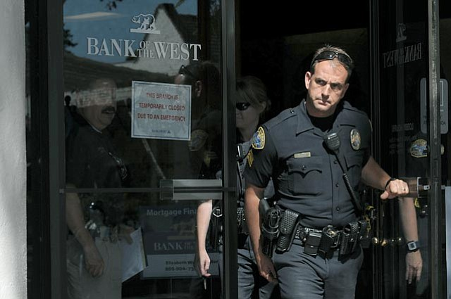 Sgt. Holtke of the SBPD leaves the Bank of the West which was closed Friday afternoon following a robbery