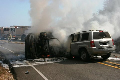 A car catches fire after a head-on collision along Highway 154 (September 6, 2011)