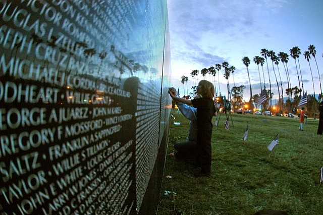The Moving Wall, a half-size replica of the Vietnam War memorial, visits Santa Barbara in 2005