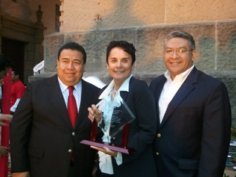 Dr. Ofelia Arellano (center), SBCC Vice President for Continuing Education, accepts the Mexican Consulate's Latino Excellence Award from consulate representative Rogelio Flores Mejia (left) and Santa Barbara County First District Supervisor Salud Carbajal.