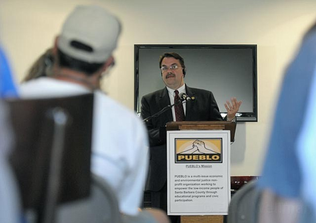 Sheriff Bill Brown discusses the policies and local impact of the Secure Communities program at a PUEBLO-sponsored event