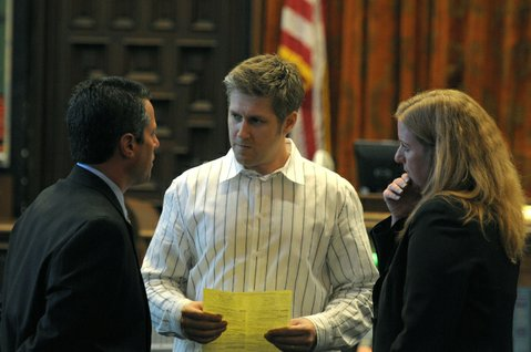 Joshua Braun (center) speaks to attorney Josh Lynn