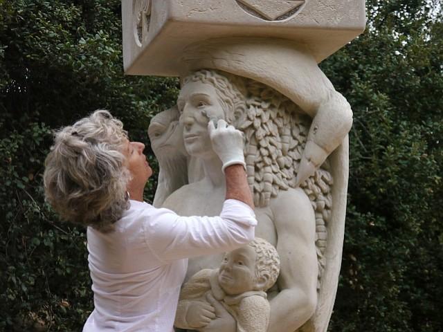 Sculptor Francis Jansen works on her <em>Pillars of Providence</em>