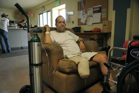"William ""Kickstand"" Armstrong sits in a chair at Casa Esperanza, where he is recovering from pacemaker surgery and a three week long induced coma. He is one of hundreds of homeless people who are discharged from Cottage Hospital each year."