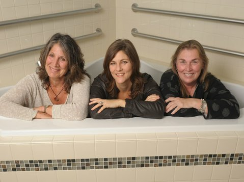 from left: Alice Levine, Laurel Phillips, and Anna Bunting pictured in one of the birthing tubs at the new Santa Barbara Birth Center.