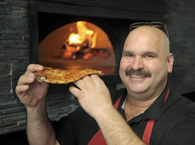 Nicky D's brother Bobby DeMarinis works the kitchen at De la Vina's newest pizzeria.