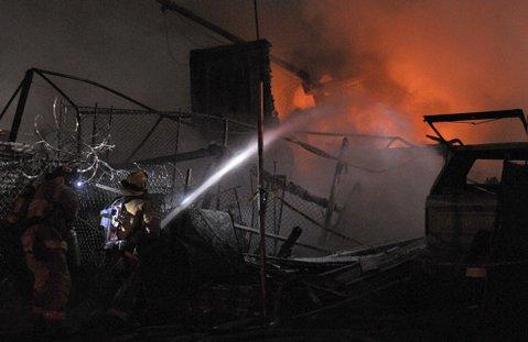 Santa Barbara City Fire responds to a Quarantina Street storage yard fire (Nov. 17, 2011)