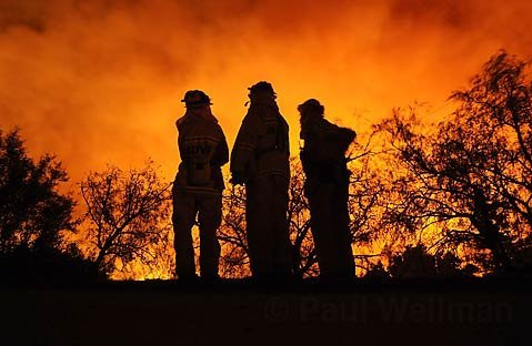 Mountain Drive volunteer firefighters watch the Tea Fire.