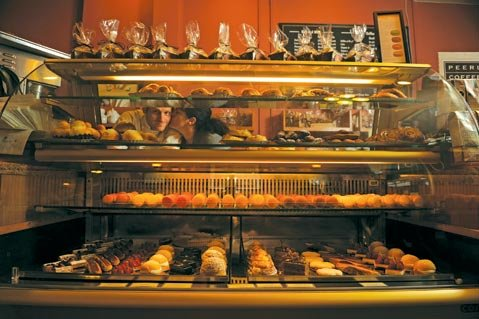 Renaud and Nicole Gonthier, behind the display case at Renaud's Patisserie and Bistro.