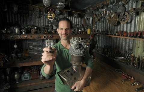 Tal Avitzur in his studio where he creates various robots from found objects.