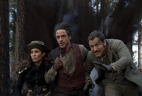 Robert Downey Jr. (center) and Jude Law return, alongside newcomer Noomi Rapace, in Guy Ritchie's stylized and over-the-top sequel <em>Sherlock Holmes: A Game of Shadows</em>.