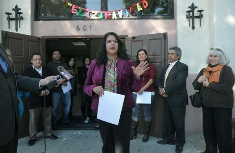 Raquel Lopez speaks to media during at a press conference Dec. 20, 2011