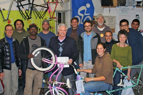 Kids' bikes refurbishers at Bici Centro.