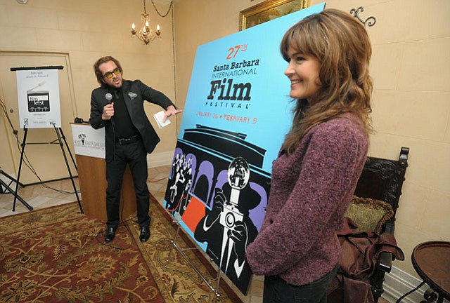 Roger Durling unveils the SBIFF 2012 poster designed by Barbara Boros (right) Jan. 5 2012.