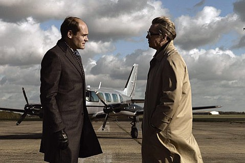 Gary Oldman (right) stars as a British Intelligence officer who comes out of retirement to uncover a Soviet spy in <em>Tinker Tailor Soldier Spy</em>.