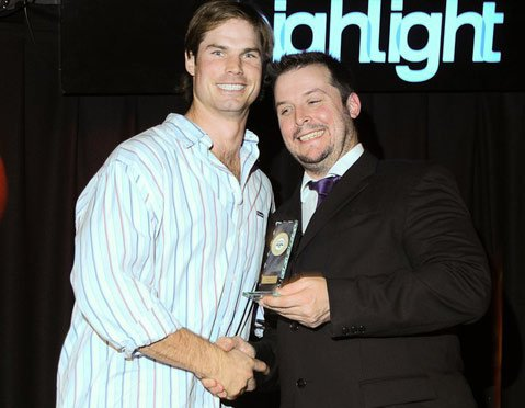 Bradlee is given the 2010 MVP trophy for the Leicester Falcons of the British American Football Association. He is pictured with Falcons general manager Guy Kersey.