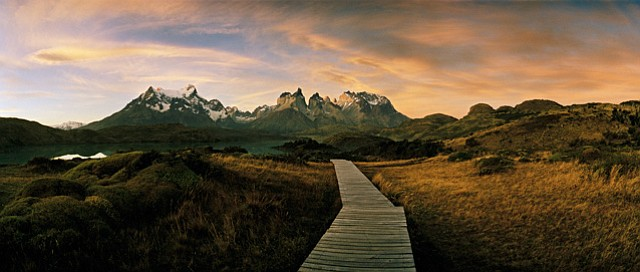 """<strong>THE MASSIF:</strong>  From Hotel Salto Chico in Torres del Paine, you can see the iconic Paine massif, its towers peaking out from the clouds and mist that surround it. """"[The] landmark towers formed from igneous granite and sedimentary layers that have been sculpted over millions of years, and at least ten periods of glaciation, into rugged emblematic profiles,"""" describes Heebner. """"The park is a jewel within a province that encompasses a diversity of ecosystems, surprisingly varied for its extreme location—from dense forest to grassy steppes, glaciers, rivers, and lakes."""""""