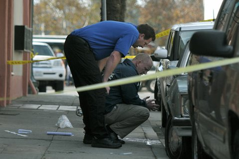 Crime Scene Investigator Mike Ullemeyer (left) and Detective Michael Claytor work the scene at 31 Parker Way where a man fell to his death.